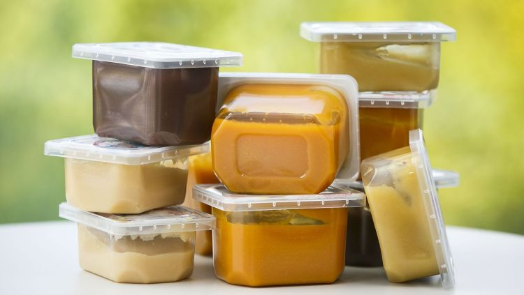 different types of baby food in containers