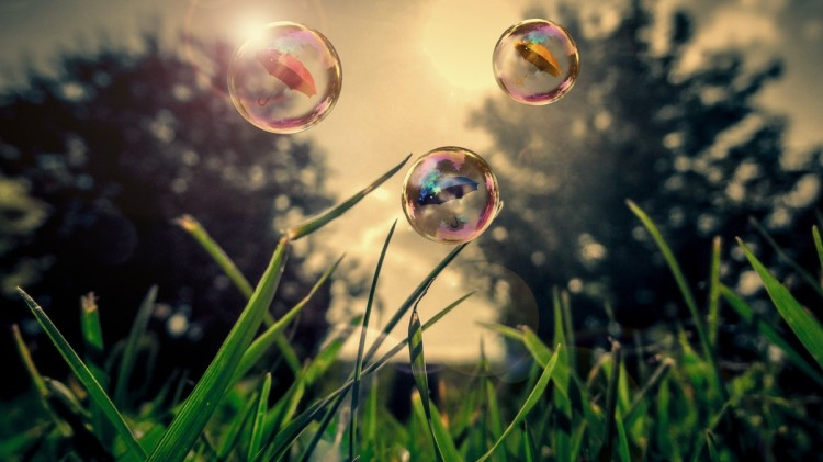 Bubbles in the air above grass